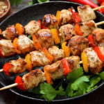 Homemade grilled chicken kebab with bell pepper in frying pan
