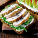 Various healthy toasted sandwiches: avocados, tomatoes, lettuce, chicken breast and curd cheese. healthy snacks